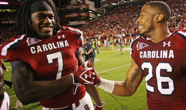 South Carolina's Jadeveon Clowney (7) and Antonio Allen celebrate their win over Navy in Columbia, S.C. on Saturday, Sept. 17, 2011. (Photo by Travis Bell/Sideline Carolina)
