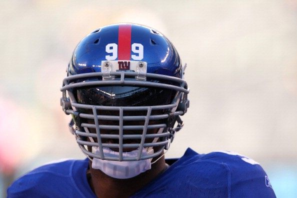 EAST RUTHERFORD, NJ - DECEMBER 18:  Chris Canty #99 of the New York Giants looks on before the game against the Washington Redskins during their game at MetLife Stadium on December 18, 2011 in East Rutherford, New Jersey.  (Photo by Al Bello/Getty Images)